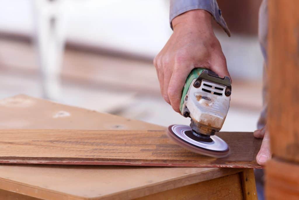 sander removing paint