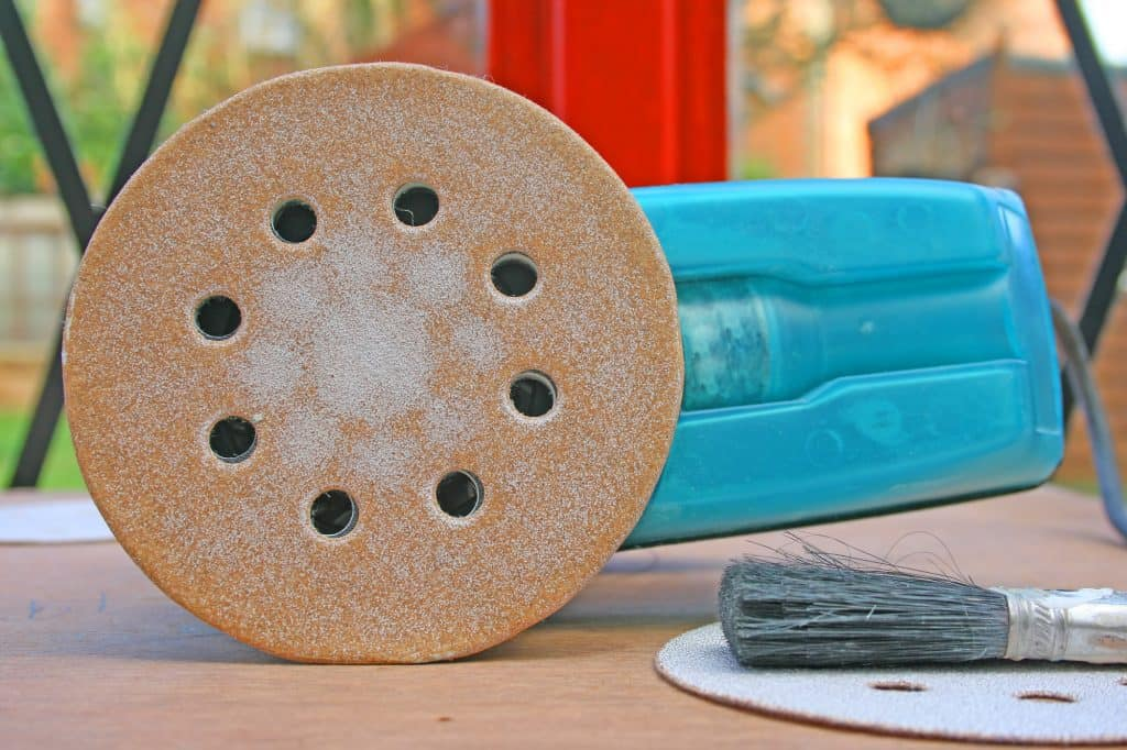 sandpaper showing on a sander