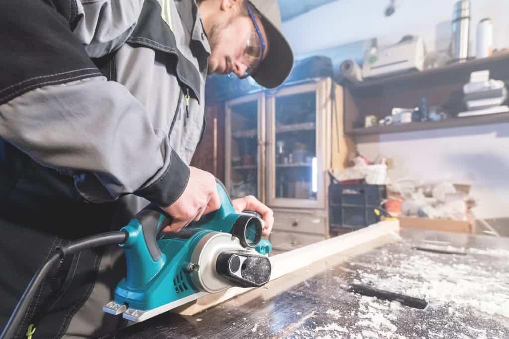 carpenter sanding trim work