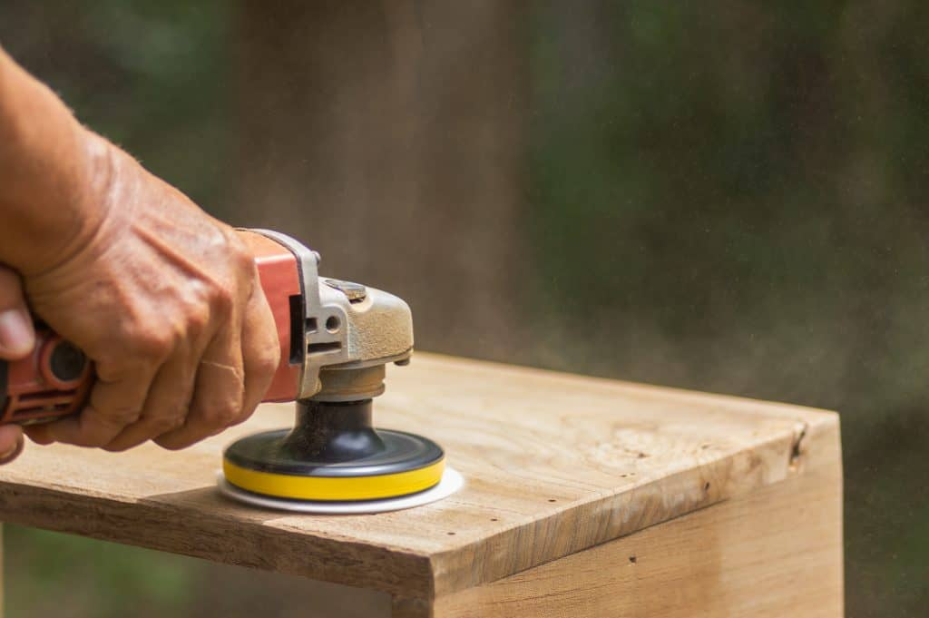 dual action sander on furniture