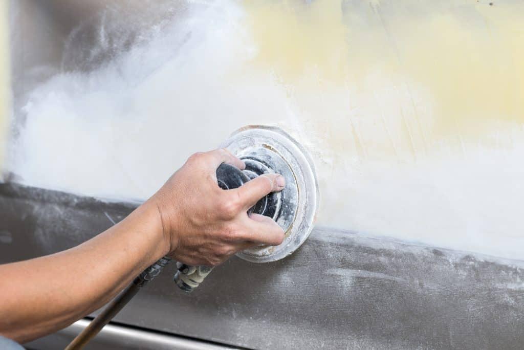 sanding a car's body paint