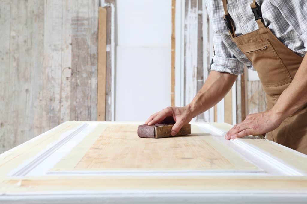 sanding a door between coats of paint