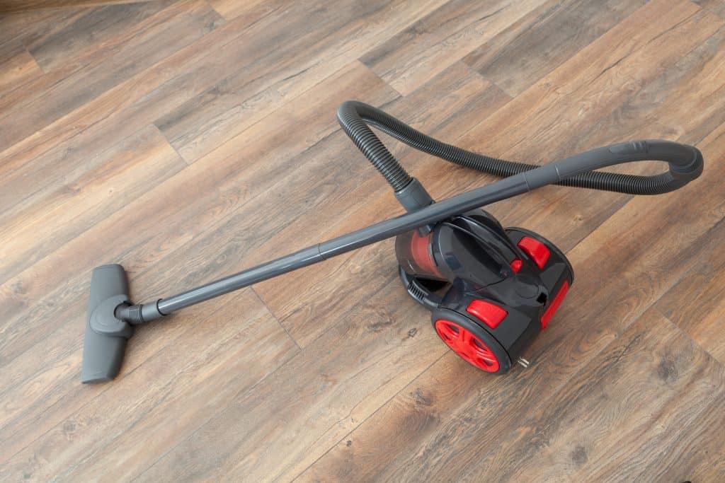 A vacuum on a freshly sanded floor