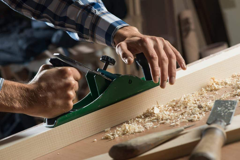 a man using a jointer