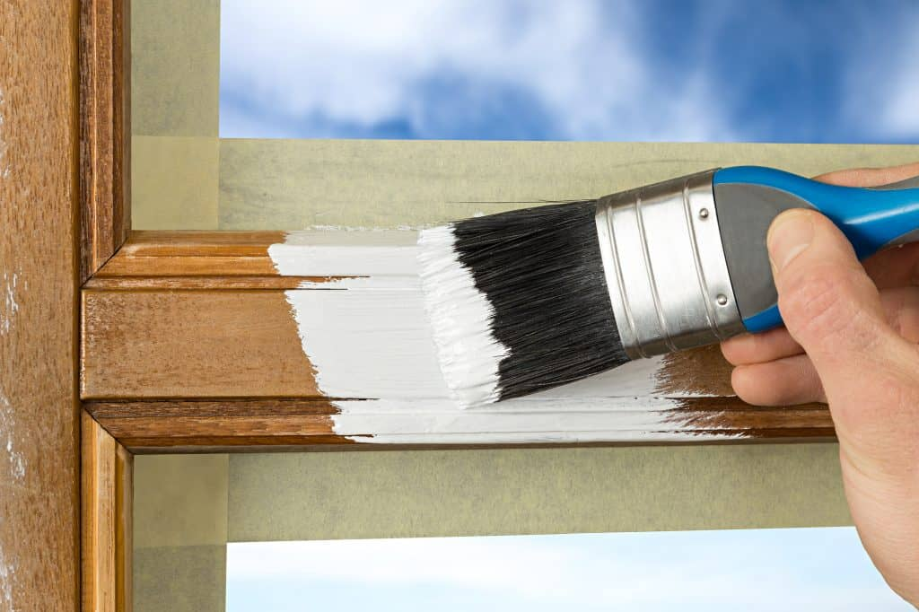 painting a wooden window trim after sanding