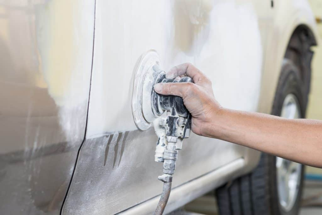 sanding a car before painting