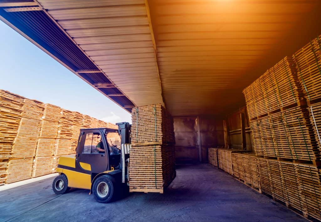 forklift loader loads lumber into a dry kiln for wood drying