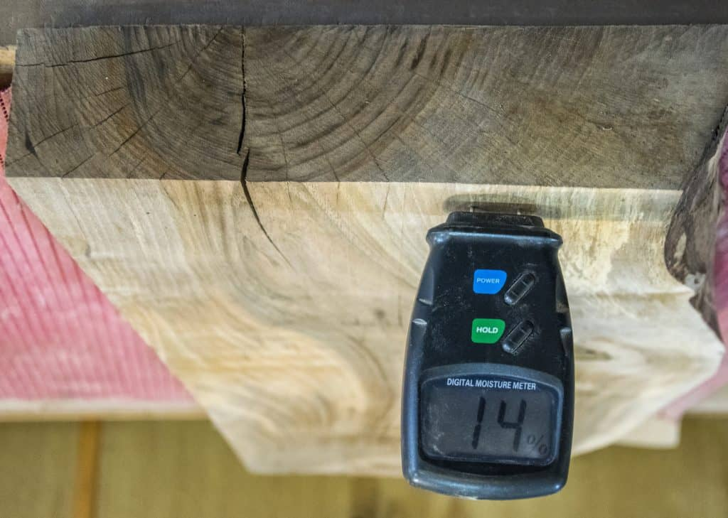 using a moisture meter to see how dry is the wood
