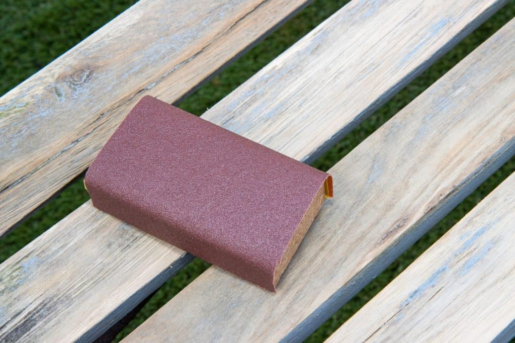 sanding block on a wooden bench