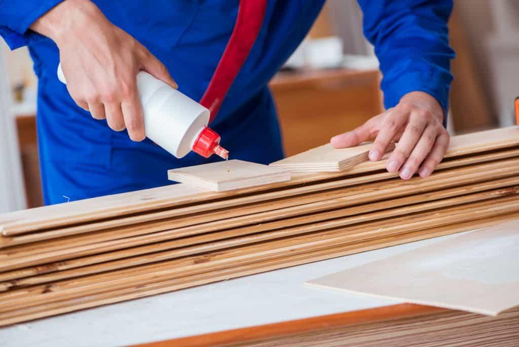 carpenter using wood glue